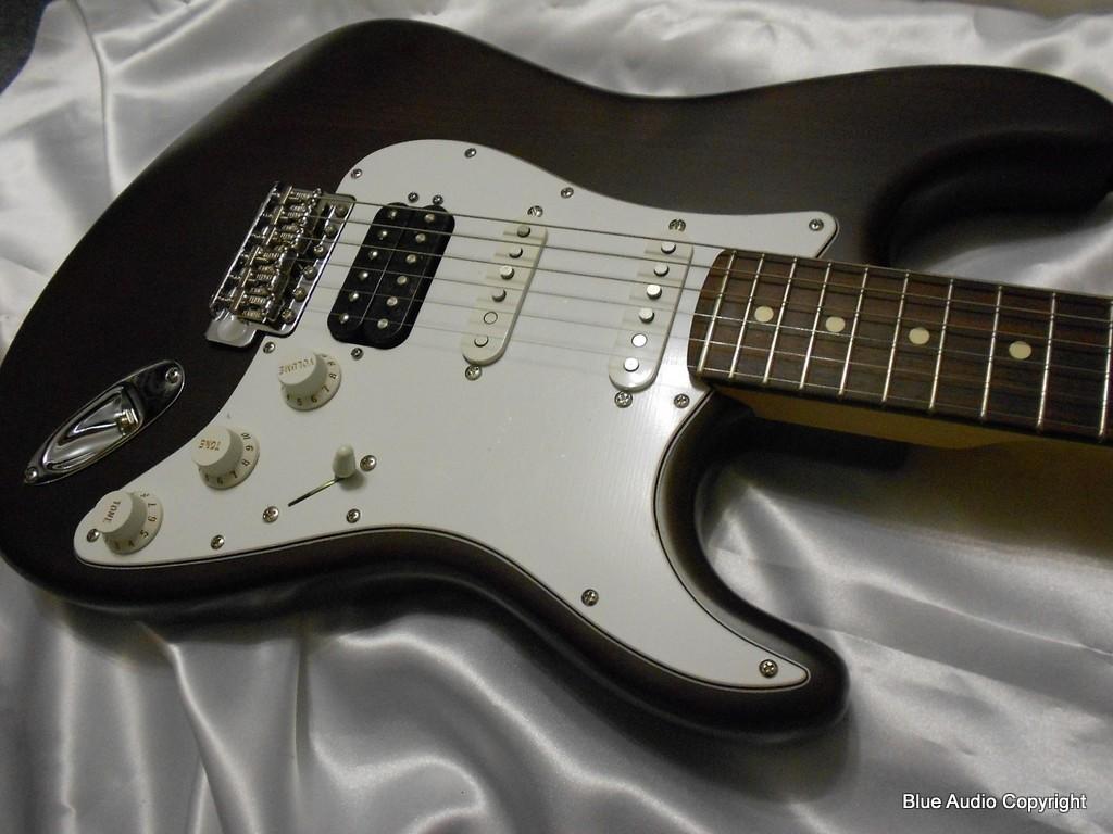FENDER Chitarra Elettrica mod.Stratocaster HIGHWAY ONE HSS (USA)  RW Cocoa Trasparent